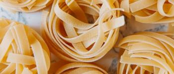 Raw tagliatelle on the table